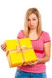 Mujer decepcionante con el regalo Imágenes de archivo libres de regalías