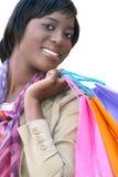 Mujer del afroamericano con los bolsos de compras aislados Imágenes de archivo libres de regalías