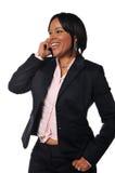 Mujer del afroamericano en el teléfono celular Imagen de archivo libre de regalías