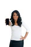 Mujer del afroamericano que sostiene un teléfono fotos de archivo
