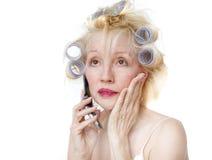 Mujer del bigudí Imagenes de archivo