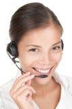 Mujer del centro de atención telefónica con el receptor de cabeza Imágenes de archivo libres de regalías