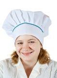 Mujer del cocinero en toca Imagen de archivo libre de regalías