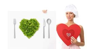 Mujer del cocinero que muestra la muestra con forma del corazón metrajes