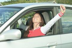 Mujer del conductor de coche feliz Imagen de archivo libre de regalías