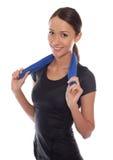 mujer del deporte con la toalla Imagen de archivo libre de regalías
