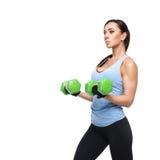 Mujer del deporte con pesas de gimnasia Fotografía de archivo libre de regalías
