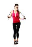Mujer del deporte que lleva a cabo la cuerda de salto Fotos de archivo libres de regalías