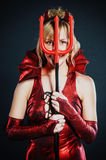 Mujer del diablo rojo Foto de archivo libre de regalías