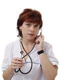 Mujer del doctor con el estetoscopio imagen de archivo libre de regalías