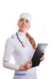 Mujer del doctor con el estetoscopio y los papeles Imagenes de archivo