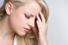 Mujer del dolor de cabeza Fotos de archivo libres de regalías
