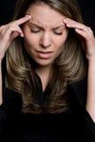 Mujer del dolor de cabeza Imágenes de archivo libres de regalías