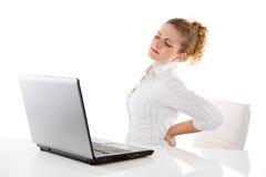 Mujer del dolor de espalda - mujer aislada en el fondo blanco Imágenes de archivo libres de regalías