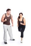 Mujer del ejercicio con el amaestrador imagen de archivo libre de regalías