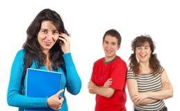 Mujer del estudiante que habla con el teléfono Foto de archivo libre de regalías