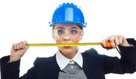Mujer del ingeniero sobre el fondo blanco Imagen de archivo libre de regalías