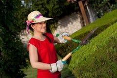 Mujer del jardinero imagenes de archivo