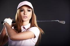 Mujer del jugador de golf. Foto de archivo