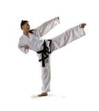 Mujer del karate en la acción aislada en blanco Imagenes de archivo