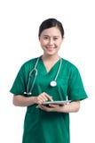 Mujer del médico con la tableta fotografía de archivo