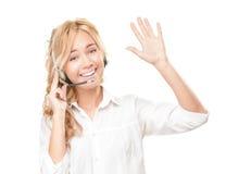 Mujer del operador de centro del servicio de atención al cliente y de llamada. Imagen de archivo