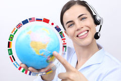 Mujer del operador del servicio de atención al cliente con la sonrisa de las auriculares, Fotografía de archivo