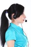 Mujer del operador en un centro de atención telefónica Imagen de archivo