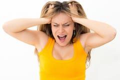 Mujer del pánico con las manos en la cabeza Fotografía de archivo libre de regalías