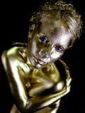 Mujer del polvo de oro Imagen de archivo libre de regalías