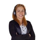 Mujer del puesto de informaciones con las auriculares Imágenes de archivo libres de regalías