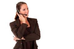 Mujer del puesto de informaciones que comunica Foto de archivo libre de regalías