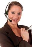 Mujer del puesto de informaciones que comunica Fotografía de archivo libre de regalías