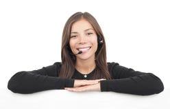 Mujer del receptor de cabeza del centro de atención telefónica Fotografía de archivo libre de regalías