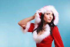 Mujer del retrato que lleva el traje de Papá Noel en azul Foto de archivo