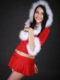 Mujer del retrato que lleva el traje de Papá Noel en negro Imagen de archivo libre de regalías
