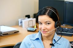 Mujer del servicio de atención al cliente imagen de archivo