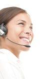 Mujer del servicio de atención al cliente con el receptor de cabeza Foto de archivo