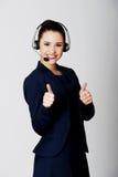 Mujer del servicio de atención al cliente con el receptor de cabeza Fotografía de archivo libre de regalías