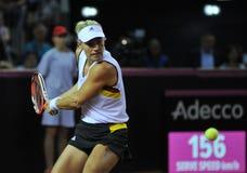 Mujer del tenis en la acción Imagen de archivo