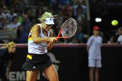Mujer del tenis en la acción Fotos de archivo