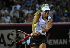 Mujer del tenis en la acción Foto de archivo
