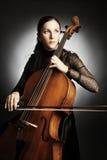 Mujer del violoncelista del jugador del violoncelo Foto de archivo libre de regalías