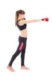 Mujer delgada atractiva en los guantes de boxeo aislados en blanco Fotografía de archivo libre de regalías