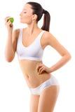Mujer delgada en la ropa interior blanca con la manzana verde en Imagen de archivo libre de regalías