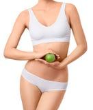 Mujer delgada en la ropa interior blanca con la manzana verde en Fotos de archivo