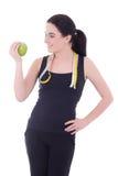 Mujer deportiva atractiva joven con el aislador de la manzana y de la cinta métrica Fotos de archivo
