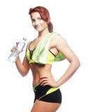 Mujer deportiva con agua mineral Fotografía de archivo libre de regalías