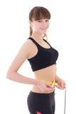 Mujer deportiva delgada hermosa joven con la cinta de la medida aislada encendido Fotografía de archivo