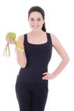 Mujer deportiva hermosa joven con isola de la manzana y de la cinta métrica Foto de archivo libre de regalías